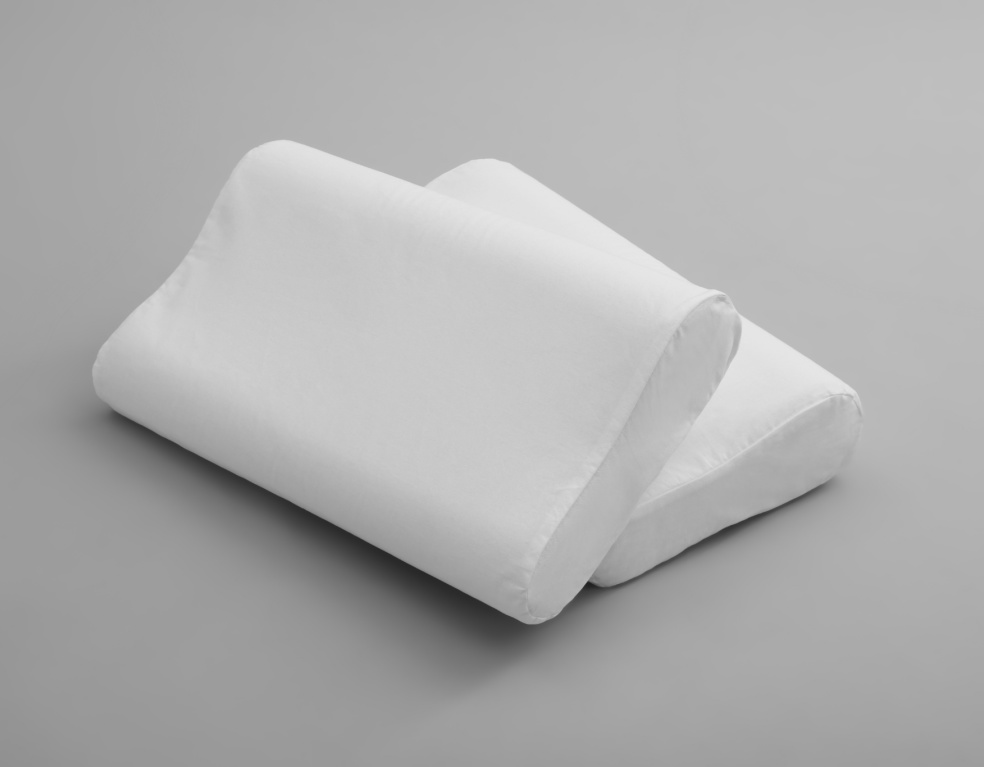 Clean soft orthopedic pillows on grey background