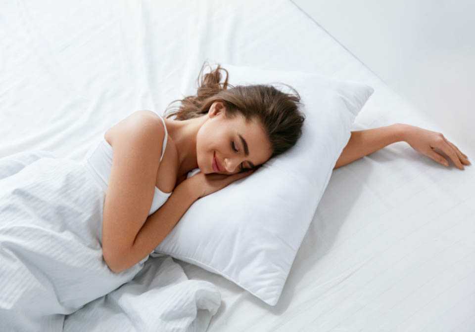 Pillows. Woman Resting On White Pillow Sleeping In Bed. High Resolution.